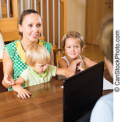 Mother and daughters with social worker - Happy mother with...