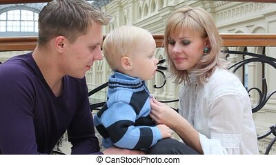 Mother and father talk with son