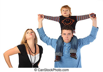 Mother and father with son on shoulders