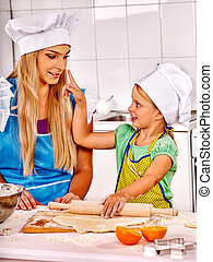 Mother and grandchild baking cookies.