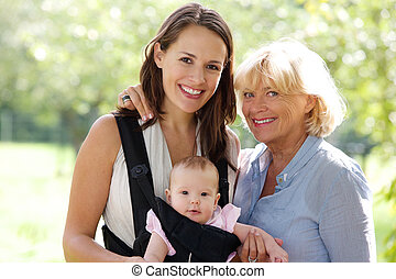 Mother and grandmother smiling with baby