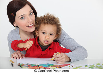 mother and her baby boy drawing