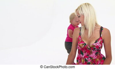 Mother And Her Baby Girl Playing With Pink Balloon