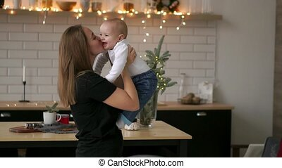 Mother and her baby son having fun and playing at home....