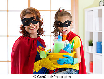 Mother and her child in Superhero costume. Mum and kid ready...