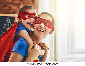 Girl and mom in Superhero costume - Mother and her child...