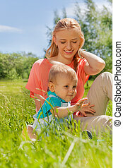 Mother and her child together in the green field