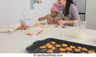 Mother and her daughter cooking tog