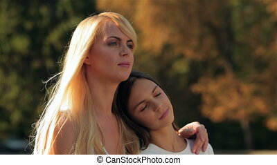 Mother and her daughter in an embrace