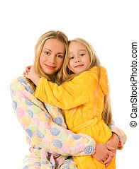 Mother and her daughter in colorful bathrobes