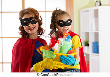 Mother and her daughter in Superhero costume. Mum and kid...