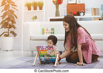 Mother and her daughter lifestyle image at home.