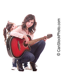 mother and her daughter with guitar