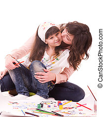 mother and her daughter with paint