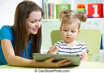 mother and her kid daughter with tablet pc