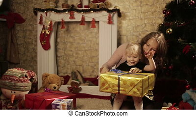 Mother and her little daughter with the gift box