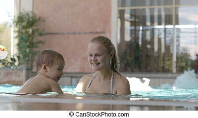 Mother and her son in the swimming pool.