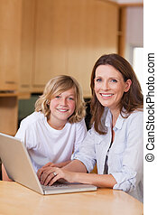 Mother and her son with laptop