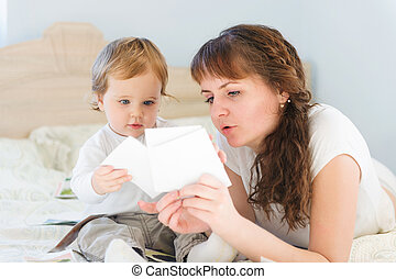 Mother and her son with paper cards