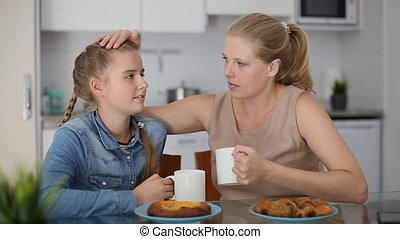 Mother and her teenage daughter having emotional dialog in ...