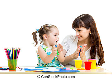 Mother and kid girl draw and making by hands