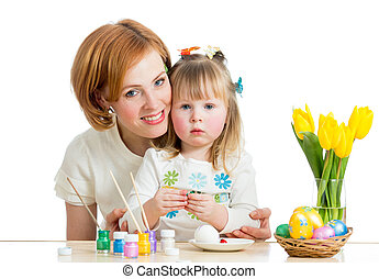 mother and kid girl paint easter eggs isolated on white