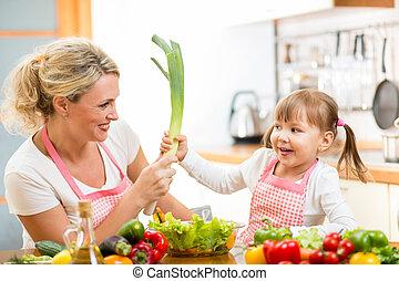 mother and kid  having fun preparing healthy food