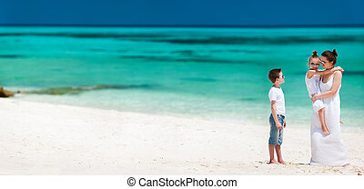 Mother and kids on a tropical beach vacation