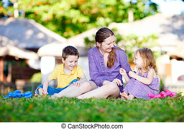Mother and kids outdoors