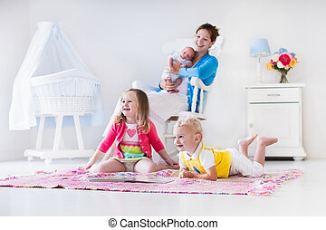 Mother and kids playing in bedroom