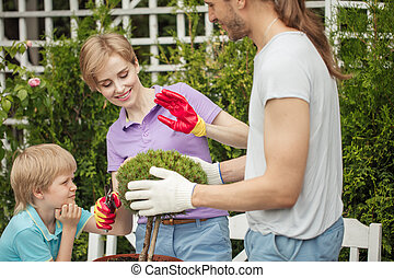 Mother and little boy shopping in gardening center