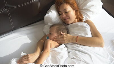 mother and little boy woke up in the morning