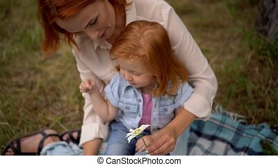 mother and little daughter tell fortune on daisy - Mom And...