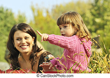 Mother and little girl in park