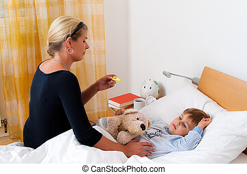 Mother and sick child in bed. Flu. Childhood diseases.