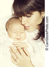 Mother and Sleeping Newborn Baby, Happy New Born Kid Sleep and smile, family portrait