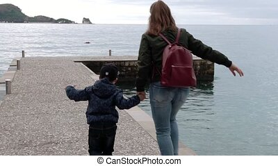 Mother And Small Son On The Pier
