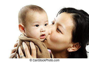 Mother and son - A mother kissing her cute baby son