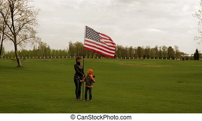 Mother and son are about the US flag