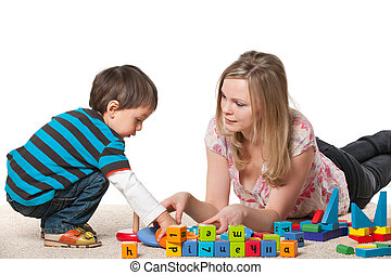 Mother and son are playing with blocks