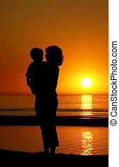 Mother And Son At Sunset
