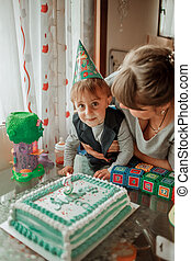 Mother and son celebrate birthday at home