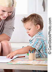 Mother and son colouring