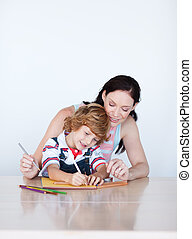Mother and son doing homework with copy-space - Mother and...