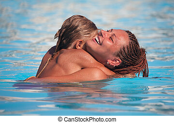 Mother and son have fun swimming