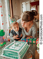 Mother and son have party - celebrate birthday at home