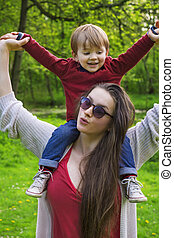 mother and son having fun in the park