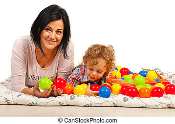 Mother and son having fun with balls
