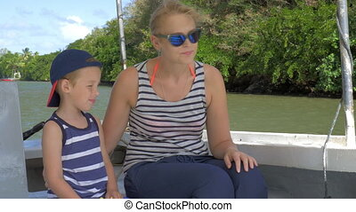 Mother and son having nature boat travel