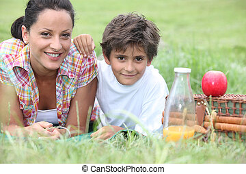 mother and son having picnic in the park